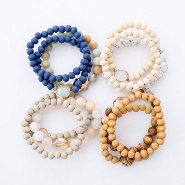 "Semi Precious Wood Beaded Crystal Stretch Bracelet Set.  - 3pcs per set - Approximately 3"" in Diameter  - Fits up to a 7"" Wrist"
