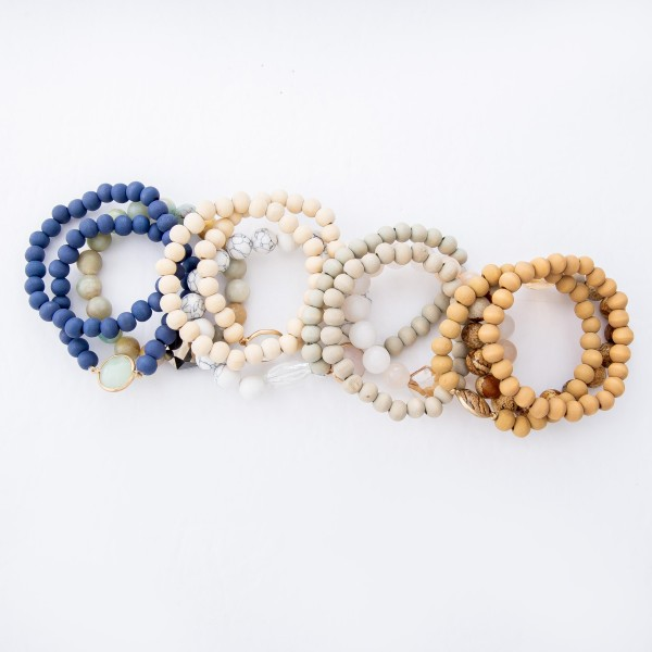 """Semi Precious Wood Beaded Crystal Stretch Bracelet Set.  - 3pcs per set - Approximately 3"""" in Diameter  - Fits up to a 7"""" Wrist"""