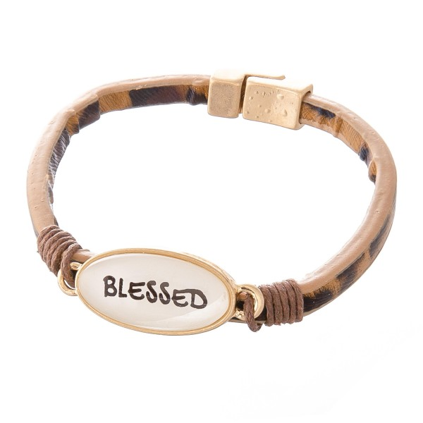 """Faux Leather Leopard Print Magnetic Bracelet Featuring """"Blessed"""" Dome Focal Detail.  - Focal 1""""  - Magnetic Closure - Approximately 2.5"""" in Diameter - Fits up to a 5"""" Wrist"""