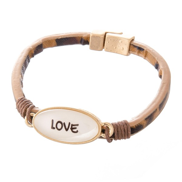 "Faux Leather Leopard Print Magnetic Bracelet Featuring ""Love"" Dome Focal Detail.  - Focal 1"" - Magnetic Closure - Approximately 2.5"" in Diameter - Fits up to a 5"" Wrist"