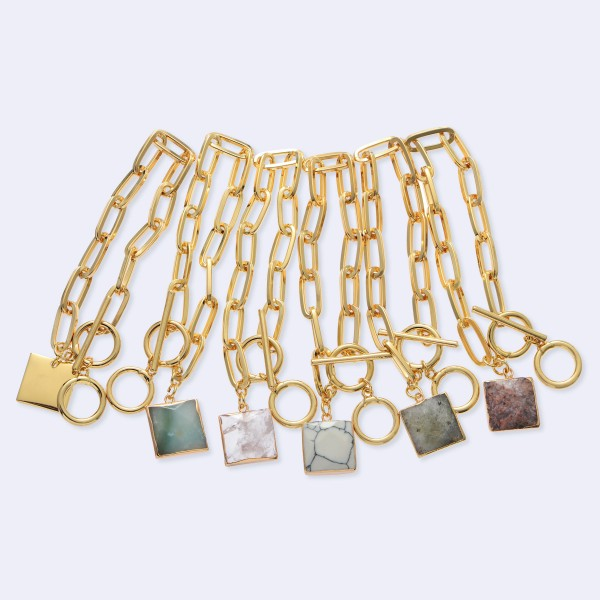 "Toggle Bar Oval Link Charm Bracelet in Gold.  - Square Charm .75"" - Approximately 3"" in Diameter - Adjustable Toggle Bar Clasp Closure"