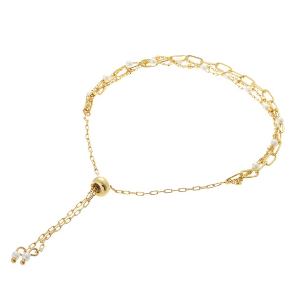 "Dainty Chain Link Pearl Bolo Bracelet in Gold.  - Adjustable Bolo Closure - Approximately 3"" in Diameter"