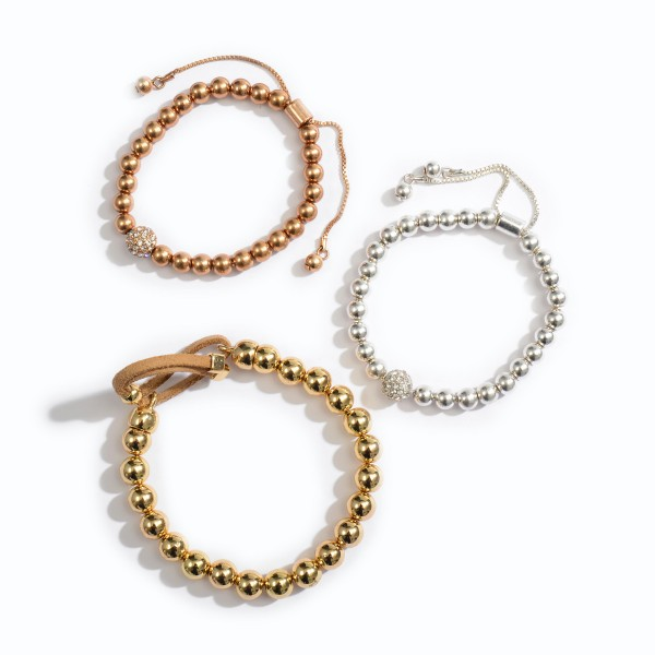 """Beaded Bolo Bracelet in Gold.  - 7mm Bead Size - Approximately 3"""" in Diameter - Adjustable Bolo Closure"""