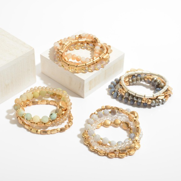 "4 PC Semi Precious Metal Beaded Stretch Bracelet Set in Gold.  - 4 PC Per Set - Approximately 3"" in Diameter"