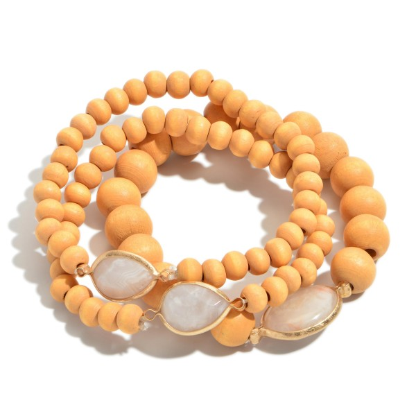 "3 PC Wood Beaded Semi Precious Stretch Bracelet Set.  - 3 PC Per Set - Bead Sizes: 4mm & 9mm  - Approximately 3"" in Diameter"