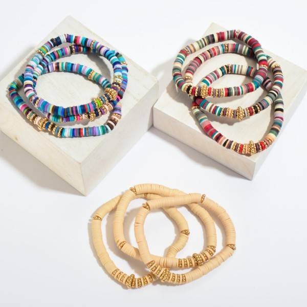 """3 PC Rubber Heishi Beaded Stretch Bracelet Set Featuring Gold Accents.  - 3 PC Per Set - Bead Diameter 5mm - Approximately 3"""" in Diameter"""