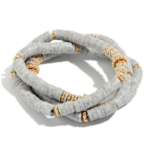 "3 PC Rubber Spacer Beaded Bracelet Set Featuring Gold Accents.  - 3 PC Per Set - Approximately 3"" in Diameter"
