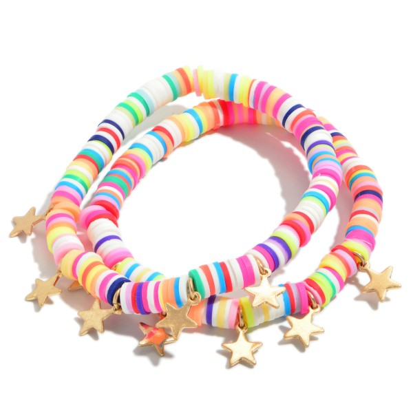 "3 PC Rubber Heishi Beaded Stretch Bracelet Set Featuring Gold Star Accents.  - 3 PC Per Set - Approximately 3"" in Diameter"