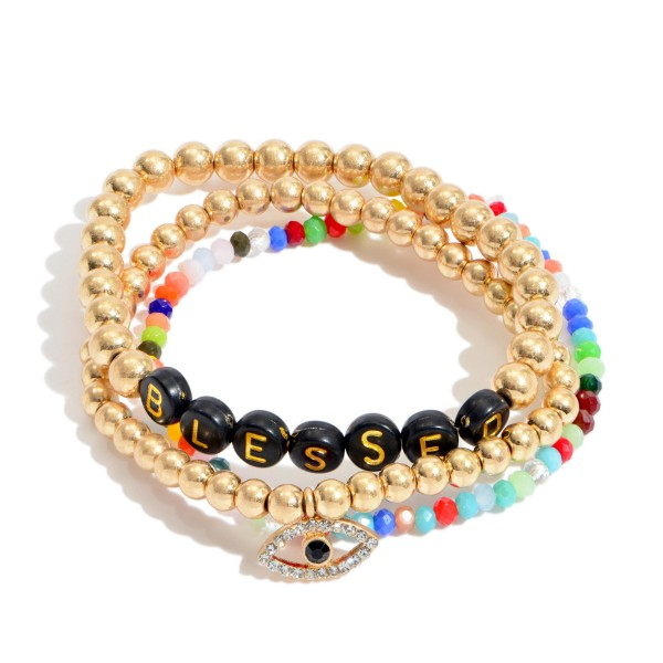 "3 PC Multicolor Pisa Beaded Stretch Bracelet Set in Gold Featuring an Evil Eye Charm.  - 3 PC Per Set - Bead Sizes 2mm - 5mm - Approximately 3"" in Diameter"