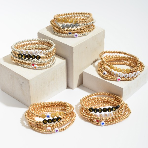 """5 PC Pisa Beaded Message Stretch Bracelet Set in Gold Featuring Heart Accents.  - 5 PC Per Set - Bead Size 2mm - 5mm - Approximately 3"""" in Diameter"""