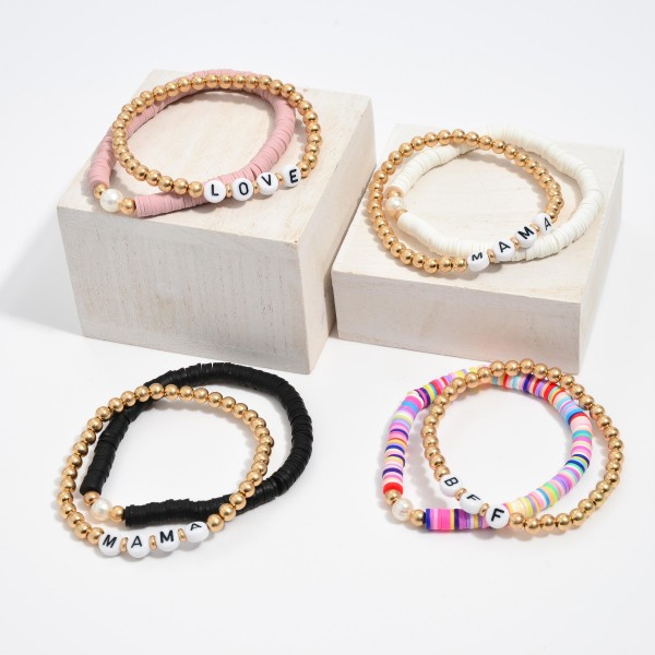 """3 PC Rubber Heishi Beaded Love Stretch Bracelet Set in Gold Featuring a Pearl Accent.  - 3 PC Per Set - Approximately 3"""" in Diameter"""