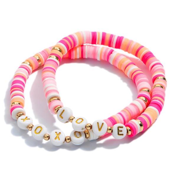"2 PC Rubber Heishi Beaded XOXO Love Stretch Bracelet Set.  - 2 PC Per Set - Approximately 3"" in Diameter"