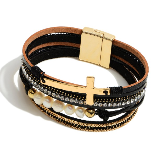 "Faux Leather Pearl Beaded Cross Magnetic Bracelet Featuring Rhinestone Details.  - Magnetic Clasp Closure - Focal 1.5""  - Approximately 3"" in Diameter"