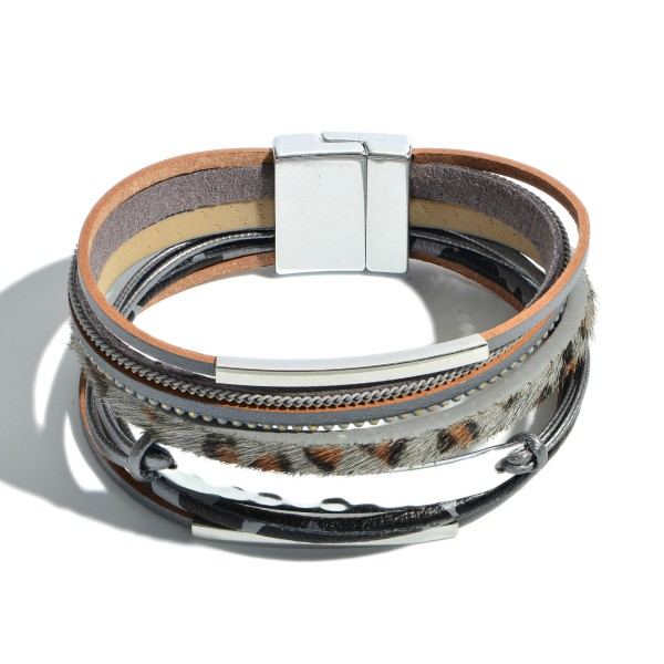 "Faux Leather Animal Print Magnetic Bracelet Featuring Hammered Focal.  - Magnetic Clasp Closure - Focal 2""  - Approximately 3"" in Diameter"
