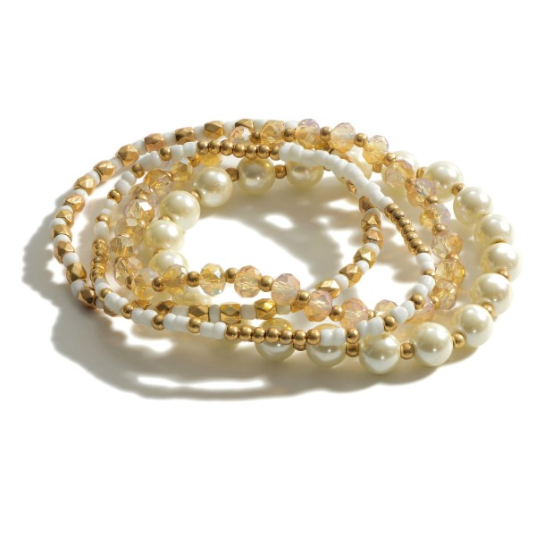 "4 PC Multi Beaded Pearl Stretch Bracelet Set.  - 4 PC Per Set  - Bead Sizes: 2mm, 4mm, 7mm  - Approximately 3"" in Diameter"