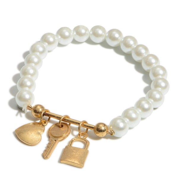 "Pearl Beaded Charm Bar Stretch Bracelet.  - Charms Include: Heart, Key & Lock - Charms approximately .5""  - Approximately 3"" in Diameter"
