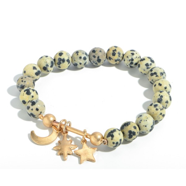 "Beaded Boho Charm Bar Stretch Bracelet.  - Charms Include: Star, Moon & North Star - Charms approximately .5"" in Size - Approximately 3"" in Diameter"
