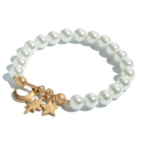 "Pearl Beaded Boho Charm Bar Stretch Bracelet.  - Charms Include: Star, Moon & North Star - Charms approximately .5"" in Size - Approximately 3"" in Diameter"