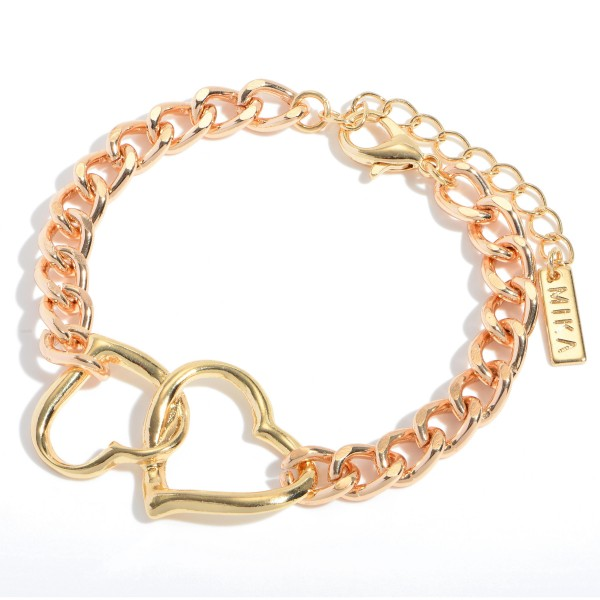 """Interlocking Heart Chain Link Bracelet in Gold.  - Focal 1.5""""  - Approximately 3"""" in Diameter - 2"""" Adjustable Lobster Clasp"""