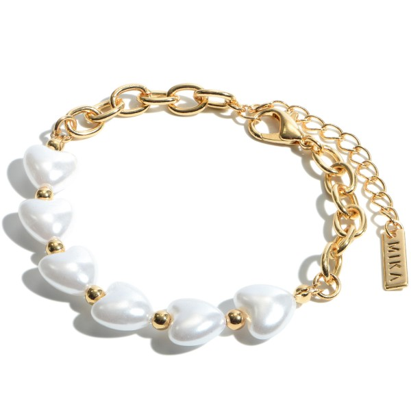 "Ivory Pearl Heart Chain Link Bracelet in Gold.  - Hearts .5"" in Size - Approximately 3"" in Diameter  - Adjustable Lobster Clasp"
