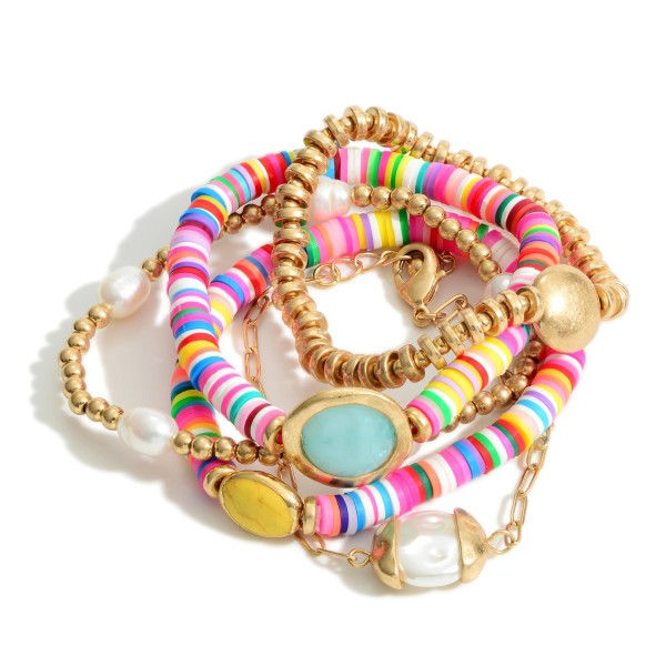 "5 PC Mix Rubber Heishi Beaded Pearl Stretch Bracelet Set.  - 5 PC Per Set - 4 Stretchy Strands; 1 Chain Link Strand - Approximately 3"" in Diameter - 2"" Adjustable Extender"