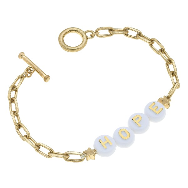 "Hope Block Letter Toggle Bar Bracelet in Worn Gold.  - Toggle Bar Clasp - Approximately 3"" in Diameter"