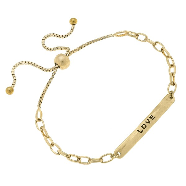 """Chain Link Love Bolo Bracelet in Worn Gold.  - Focal 1.75""""  - Approximately 3"""" in Diameter  - Adjustable Bolo Clasp"""