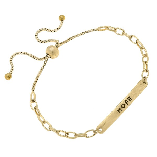 "Chain Link Hope Bolo Bracelet in Worn Gold.  - Focal 1.75""  - Approximately 3"" in Diameter  - Adjustable Bolo Clasp"