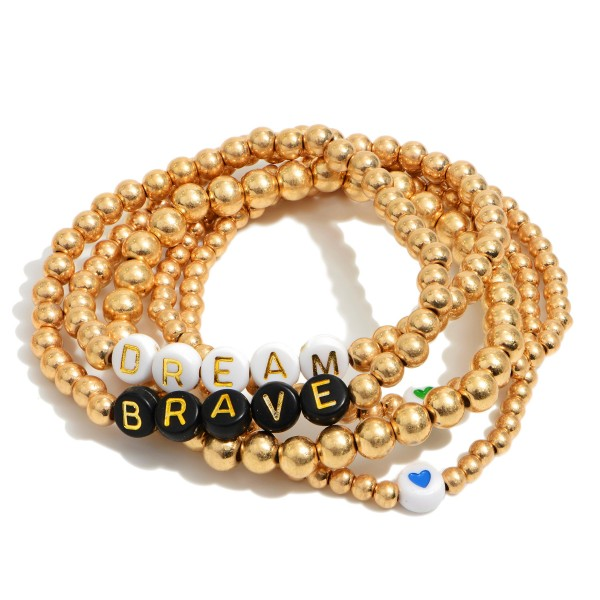 """5 PC Beaded Block Letter Stretch Bracelet Set in Gold Featuring Heart Accents.  - Bead Sizes: 3mm - 4mm - Approximately 3"""" in Diameter"""