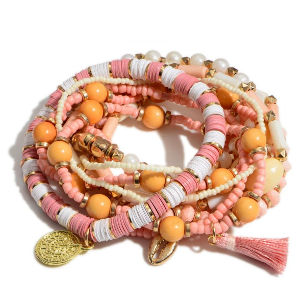 "10 PC Multi Pink Beaded Puka Shell Stackable Stretch Bracelet Set.  - 10 PC Per Set - Approximately 3"" in Diameter"