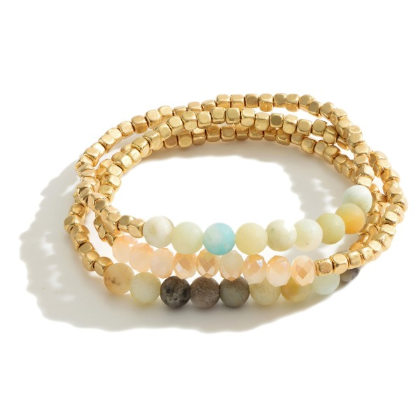 "Set of Three Matte Gold Beaded Bracelets Featuring Natural Stone Accents.   - Approximately 3"" in Diameter"