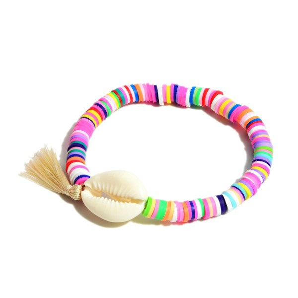 "Heishi Bead Bracelet Featuring Puka Shell and Tassel Accents.   - Approximately 3"" in Diameter"