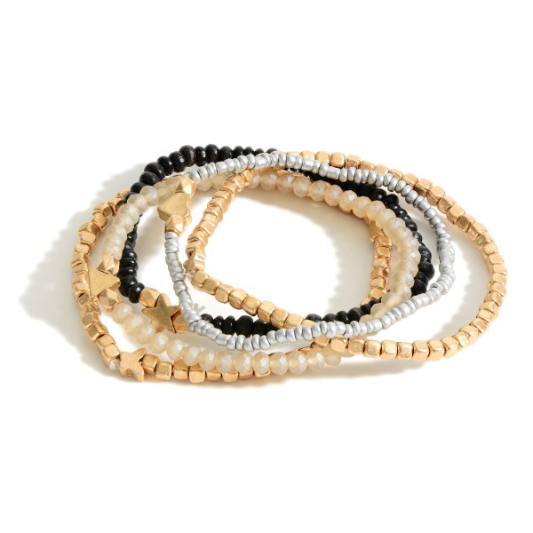 """Set of Four Beaded Bracelets Featuring Metal Accents and Star Details.   - Approximately 2.5"""" in Diameter"""