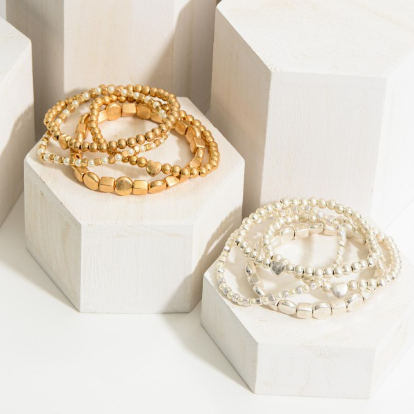 """Set of Three Beaded Metal Bracelets Featuring Heart Details and Faux Pearl Accents.   - Approximately 3"""" in Diameter"""