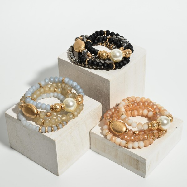 "Set of Four Beaded Strech Bracelets Featuring Worn Gold Details and Faux Pearl Accents.   - Approximately 2.5"" Long"