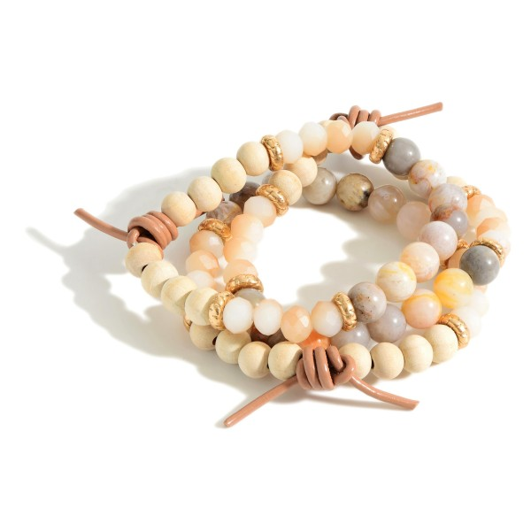 "Set of Three Beaded Bracelets Featuring Wood Accents and Natural Stone Details.   - Approximately 3"" in Diameter"