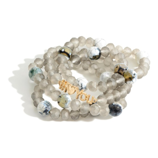 "Set of Four Beaded Bracelets Featuring Natural Stone Accents and Gold Detail that Says ""#IHeartYou"".   - Approximately 3"" in Diameter"
