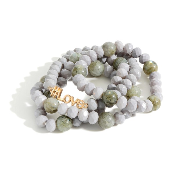 "Set of Four Beaded Bracelets Featuring Natural Stone Accents and Gold Detail that Says ""#LOVE"".   - Approximately 3"" in Diameter"