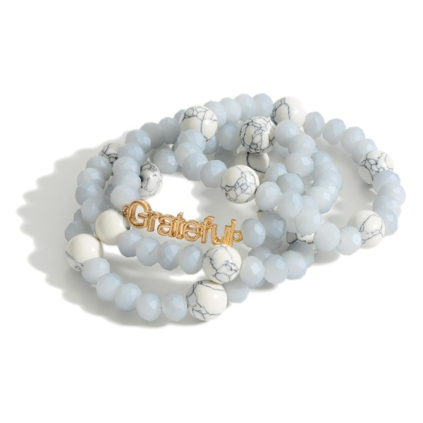 "Set of Four Beaded Bracelets Featuring Natural Stone Accents and Gold Detail that Says ""#GRATEFUL"".   - Approximately 3"" in Diameter"
