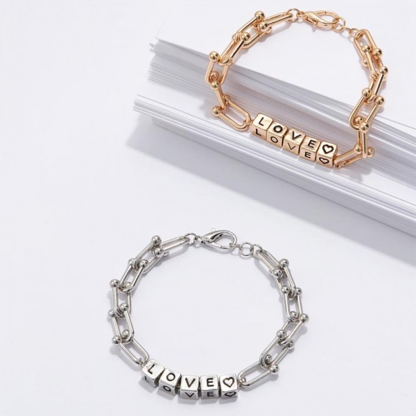 """Metal Chain Bracelet Featuring Cubed Letter Beads that Spell """"LOVE"""".   - Approximately 3"""" in Diameter  - Lobster Clasp Closure  - Adjustable 2.5"""" Extender"""