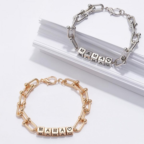 "Metal Chain Bracelet Featuring Cubed Letter Beads that Spell ""MAMA"".   - Approximately 3"" in Diameter  - Lobster Clasp Closure  - Adjustable 2.5"" Extender"