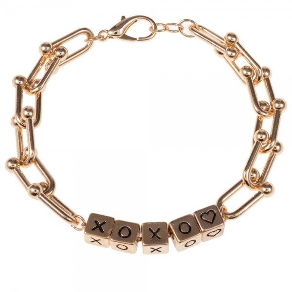 """Metal Chain Bracelet Featuring Cubed Letter Beads that Spell """"XOXO"""".   - Approximately 3"""" in Diameter  - Lobster Clasp Closure  - Adjustable 2.5"""" Extender"""