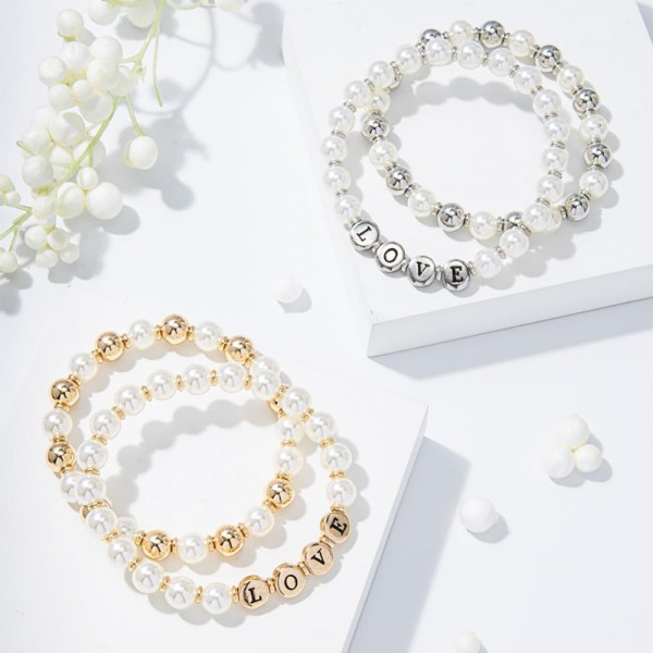 "Set of Two Beaded Bracelets Featuring Faux Pearl Accents and Metal Letter Beads that Say ""Love"".   - Approximately 3"" in Diameter"