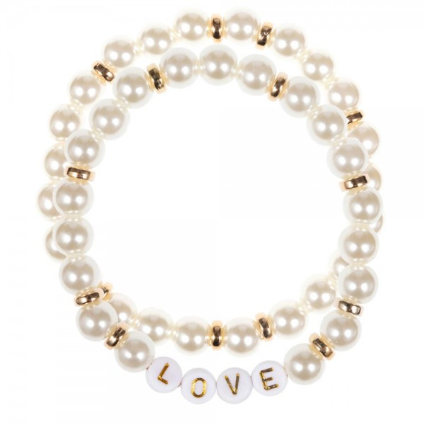 "Set of Two Faux Pearl Stretch Bracelets Featuring Letter Bead Bracelets that Spell ""LOVE"".   - Approximately 3"" in Diameter"