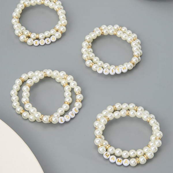 "Set of Two Faux Pearl Stretch Bracelets Featuring Letter Bead Bracelets that Spell ""XOXO"".   - Approximately 3"" in Diameter"