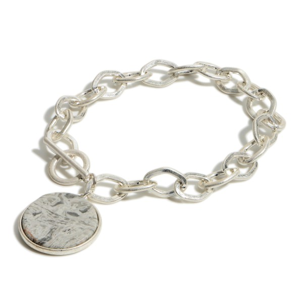 "Silver Chain Link Bracelet Featuring Natural Stone Pendant.   - Approximately 2.5"" Diameter  Toggle Closure"
