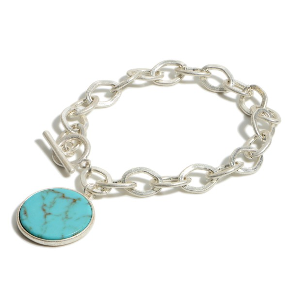"""Silver Chain Link Bracelet Featuring Natural Stone Pendant.   - Approximately 2.5"""" Diameter  Toggle Closure"""