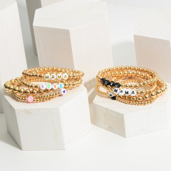 """Set of Five Gold Beaded Bracelets Featuring Letter Beads that Say """"Love"""" and """"Mama"""".   - Approximately 3"""" in Diameter"""