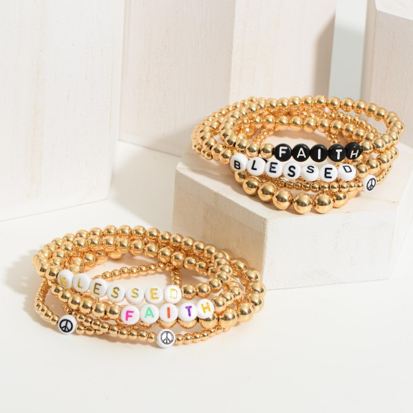 """Set of Five Gold Beaded Bracelets Featuring Letter Beads that Say """"Blessed"""" and """"Faith"""" with Peace Sign Accents.   - Approximately 3"""" in Diameter"""