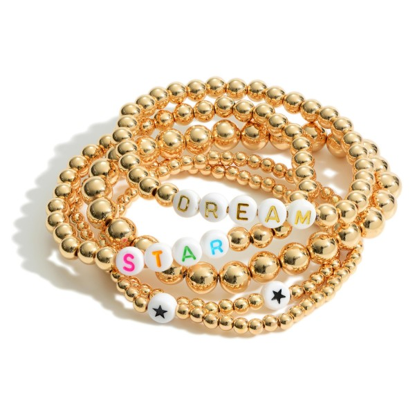 """Set of Five Gold Beaded Bracelets Featuring Star Accents and Letter Beads that Say """"Dream"""" and """"Star"""".   - Approximately 3"""" in Diameter"""